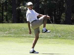 The prancing buffoon named Barack Obama.