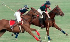 Prince Charles playing polo
