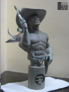 Foolkiller statue - gun raised from side