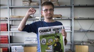 Charlie Hebdo fist in air